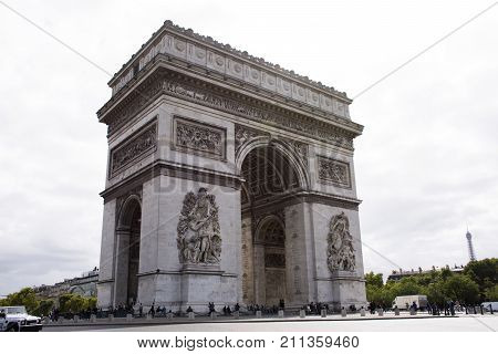 French People And Foreigner Travlers Walk Visit Arc De Triomphe De L'etoile Or Triumphal Arch Of The