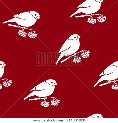 Seamless Pattern with a Bullfinch Bullfinch Sitting on a Branch with Bunches of Rowan on a Red Background Christmas Decorations Vector Illustration