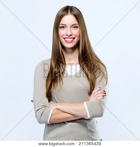Beautiful Young Woman Looking At Camera Over White Background.