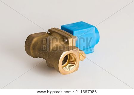 a new magnetic electro valve on a gray background. Hydraulic or pneumatic valve with electro-magnetic control poster