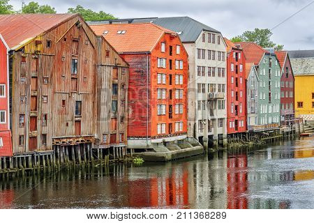 Historical Old Timber Buildings And The River Nidelva In Trondheim.