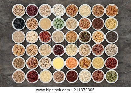 Macrobiotic health food with a selection of legumes, seeds, nuts, grains, vegetables, cereals and whole wheat pasta with super foods high in protein, omega 3, anthocyanins, antioxidants and vitamins.