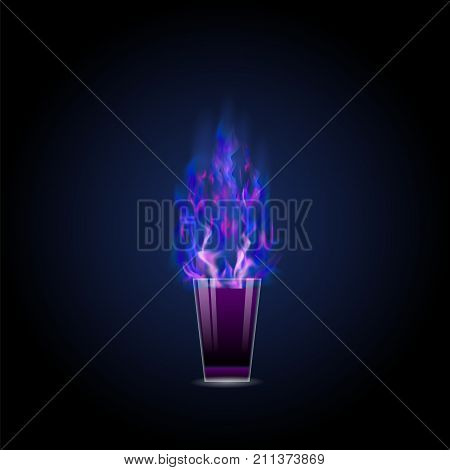 Burning drink with blue fire flame on dark gradient background. Alcohol cocktail shot