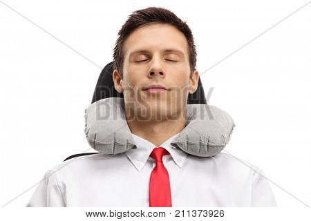 Formally dressed guy sleeping with a neck pillow isolated on white background