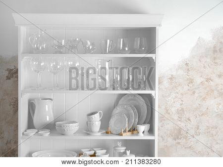 Storage stand with glassware and tableware indoors