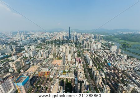 Skyscrapers and residential area of Shenzhen city at sunny day, China