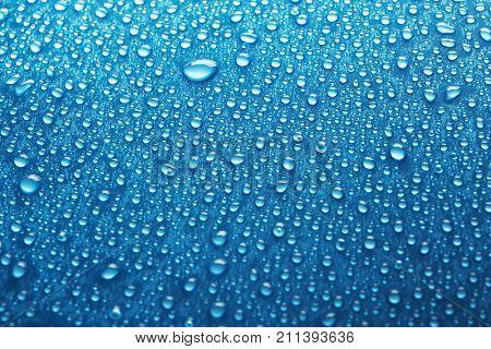 Water drops on car window, closeup
