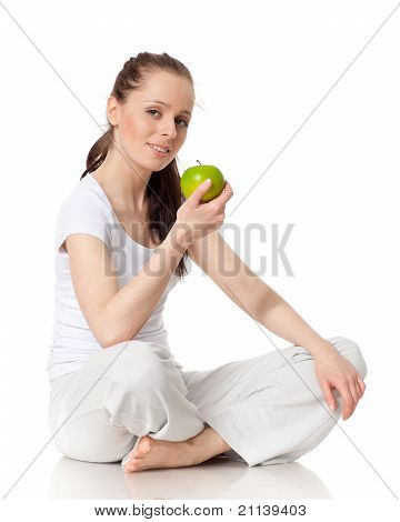 Young Beautiful Woman With An Apple.