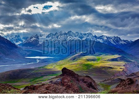 Himalayan landscape near Chandra Tal lake with sun rays coming through clouds. Himachal Pradesh, India Spiti Valley, Himachal Pradesh, India
