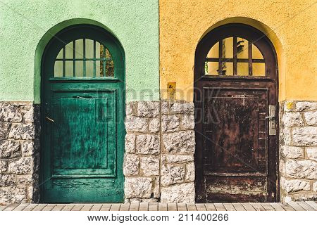 Two old doors on different buildings. Choose your way