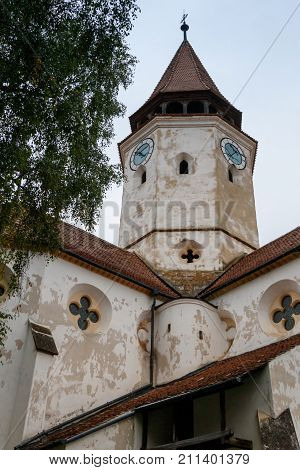 Fragment of the church and the watchtower with the clock of the Fortified Church Prejmer in Prejmer city in Romania