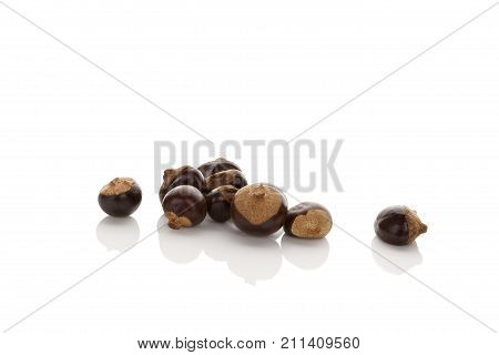 Guarana. Dietary supplement guarana seeds isolated on white background.