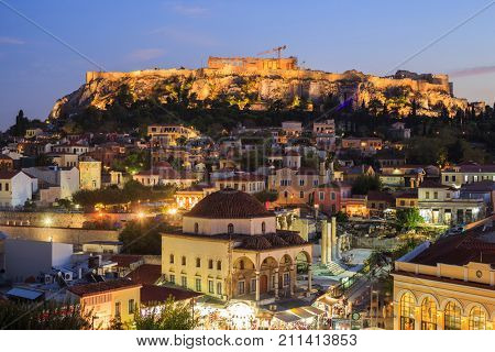 Acropolis rock illuminated in the evening. Athens, Greece.