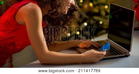 Happy Young Housewife With Credit Card Making Online Christmas Purchases