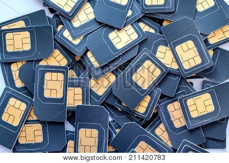 many SIM cards is in a pile, slide grey SIM cards