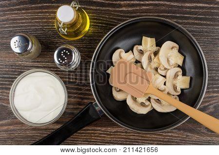 Raw Mushrooms In Frying Pan, Oil, Salt, Pepper, Sour Cream