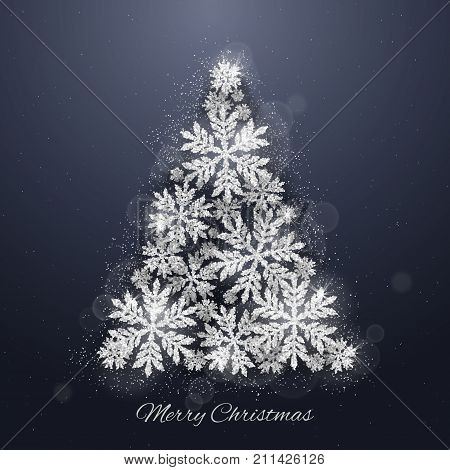 Christmas and new year dark blue background with Christmas tree made of silver glittering snowflakes on dark background. Merry Christmas greeting card