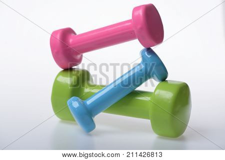 Dumbbells Made Of Blue And Green Plastic On White Background