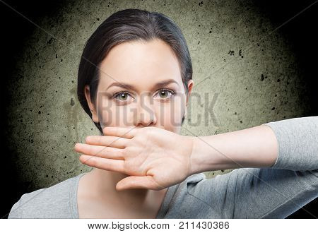 Mouth hand woman shut white background isolated