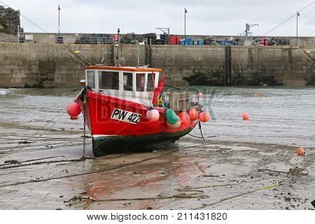 Fishing boat waiting for the tide in Newquay harbour