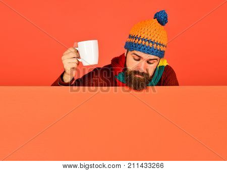 Hipster With Beard And Curious Face Has Tea Looking Down