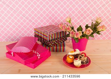 Birthday pastry on pink plate in interior