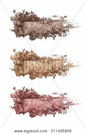 Set of eyeshadow sample isolated on white background. Crushed brown and marsala metallic eyeshadow. Closeup of a makeup product.