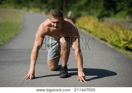 Man On Start Position To Run On Road