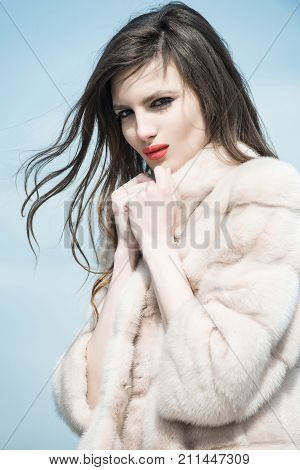 Woman With Long Brunette Hair And Red Lips In Coat.