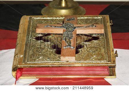 Holy Bible Golden Cross. Closeup Of An Old Golden Cross Necklace On An Ancient Book (holy Bible)