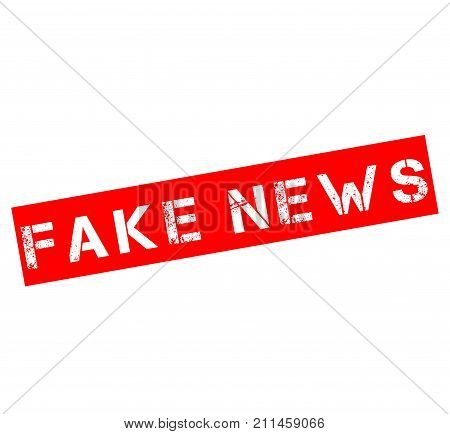 Rubber stamp with text fake news with a white background