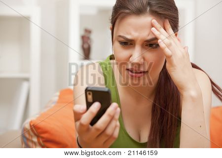 Shocked Woman Looking At Phone