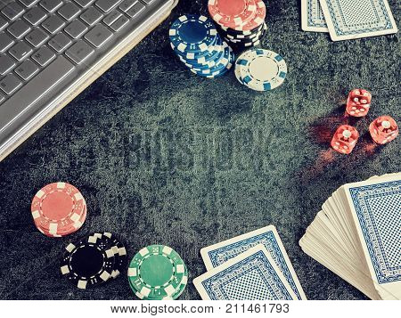 Set of poker chip or counter with card dice computer. Player open card in table. Gambling game fortune entertainment concept online casino.