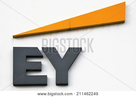 Horsens, Denmark - October 22, 2017: Ernst & Young logo on a wall. Ernst & Young also called EY is one of the largest professional services firm in the world and is one of the Big Four accounting firms