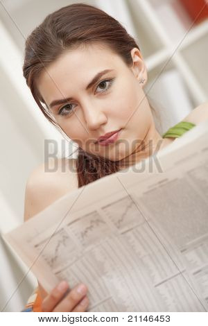 Woman With Newspaper At Home