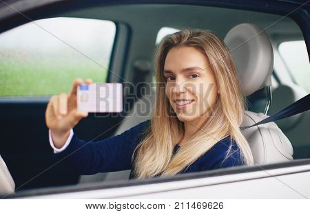 Woman with driving license, young driver, new car