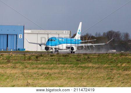 LANGENHAGEN / GERMANY - OCTOBER 28 2017: Embraer ERJ-175 from airline KLM drives to runway on international airport Langenhagen / Hanover.