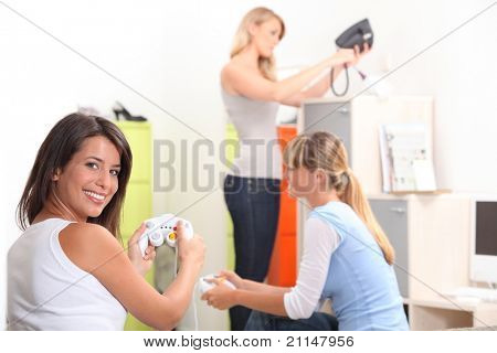 Young women playing video games