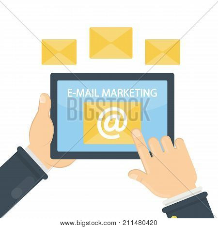 E-mail marketing concept. Hands holding tablet with mailbox.