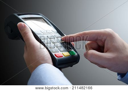Hand Using Credit Card Payment Machine