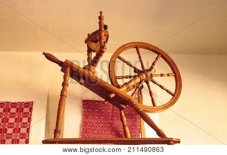 Thread spinning wheel used for spinning thread or yard from fibers to create fabric.