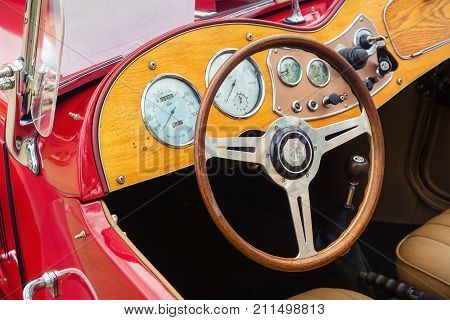 Westlake Texas - October 21 2017: Interior view of a red 1951 MG TD classic car. Closeup of wooden dashboard gauge and steering wheel.
