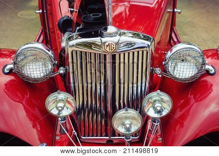 Westlake Texas - October 21 2017: Front view headlights and the grille of a red 1951 MG TD classic car.