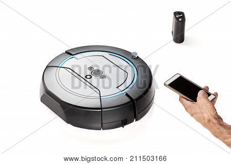Close up of hand using smartphone to control robotic vacuum cleaner