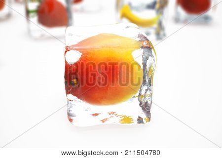 Mango in ice cube isolated on white with depth of field effects. Ice cubes with fresh berries. Berries fruits frozen in ice cubes. 3D rendering