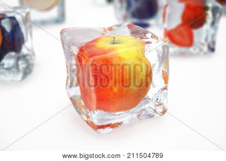 Apple in ice cube isolated on white with depth of field effects. Ice cubes with fresh berries. Berries fruits frozen in ice cubes. 3D rendering