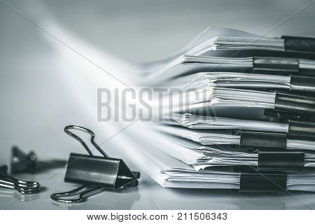 extreamly close up stacking of office working document with paper clip folder vintage color tone