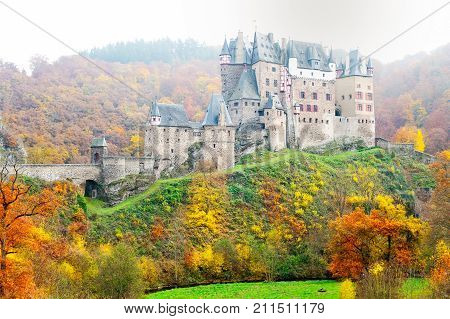Burg Eltz picturesque medieval castle at the rhine valley Germany. Fall season in hills above the Moselle River between Koblenz and Trier Germany. Spectacular colored outdoors horizontal image.