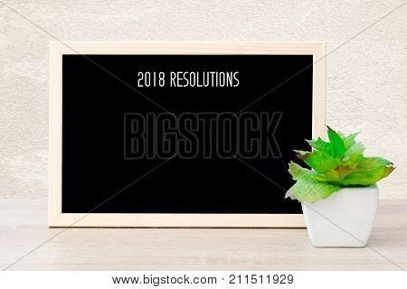 2018 resolutions on blank chalkboard background copy space for text new year business background