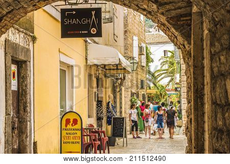 Budva, Montenegro - August 28, 2017: Old Town  Budva, Montenegro. The first mention of this city - more than 26 centuries ago. We see ancient houses, a very narrow street, cafes, shops.